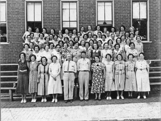 Fitting room employees of the Goodman Shoe Company, 1937. Included are Alice Wolfinger, Minnie Engel, Margaret Rudolph, and Emma Wolfinger. It later became the Drew Shoe Company.