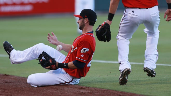 El Paso shortstop Nick Noonan is unable to come up with a catch after chasing a foul ball down the third base line Thursday.
