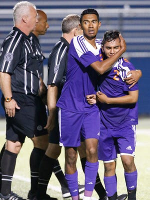 Eastlake's Noe Flaco hugs Larry Segura at the end of action in the UIL State Championships last month in Georgetown, Texas.