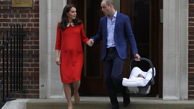 In this April 23, 2018 file photo, Britain's Prince William and Kate, Duchess of Cambridge with their newborn baby son, leave the Lindo wing at St. Mary's Hospital in London London. With another royal baby on the horizon, the debate over postpartum perfection is alive and well.
