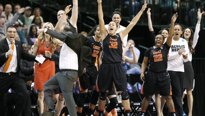 The Oregon State bench erupts on a buzzer beater shot to end the first half of a regional final of the women's NCAA Tournament basketball game against Baylor Monday, March 28, 2016, in Dallas.