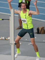 Derek Drouin reacts after clearing 7-10.50 and winning the high jump, Moscow Games Rematch at the Drake Relays on Friday, April 25, 2014, at Drake Stadium in Des Moines, Iowa.