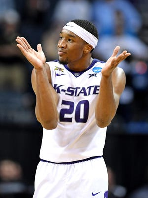 Kansas State Wildcats forward Xavier Sneed (20) reacts during the second half against the UMBC Retrievers in the second round of the 2018 NCAA Tournament at Spectrum Center.