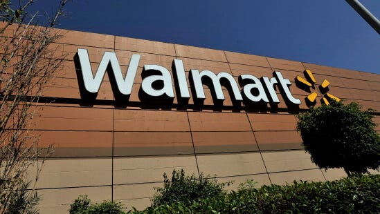 Wal-Mart's campaign comes as critics blast the company over low wages.
