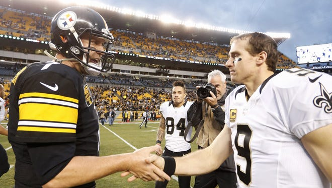Pittsburgh Steelers quarterback Ben Roethlisberger (left) greets New Orleans Saints quarterback Drew Brees (9) after their game at Heinz Field.