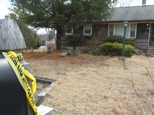 Crime scene tape hangs from the mailbox outside a Cedar Bridge Avenue home in Brick on Monday. Police arrested Christopher C. Dalzell in the stabbing of a 50-year-old woman there Sunday night, according to the Ocean County Prosecutor's Office.