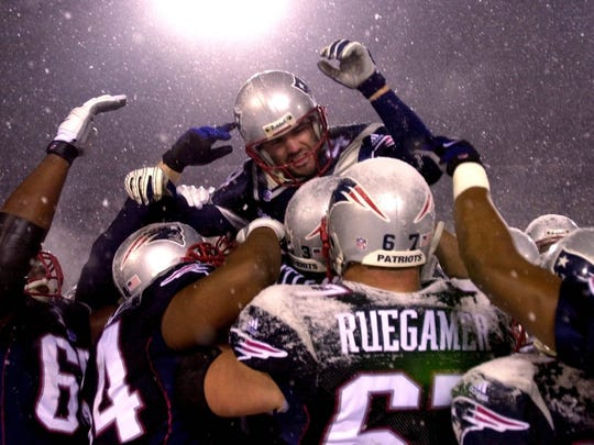 Adam Vinatieri is carried off the field by his New England Patriots teammates after making a game-winning field goal in the 2002 NFL playoffs.