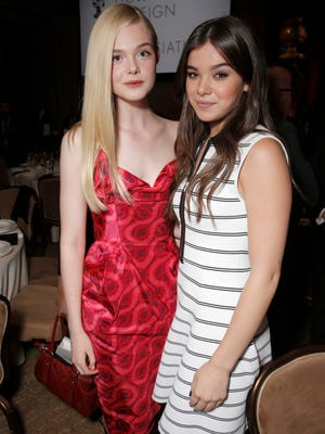 Elle Fanning, left, and Hailee Steinfeld attend the Hollywood Foreign Press Association's Grants Banquet at the Beverly Hilton hotel on Thursday, Aug. 14, 2014, in Beverly Hills, Calif.