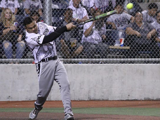 Bud Light Guam's Tony Yatar rips a three-run walk off