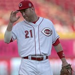 Reds third baseman Todd Frazier tips his hat to the crowd prior to the start of the second inning of a game against the Twins on June 29.
