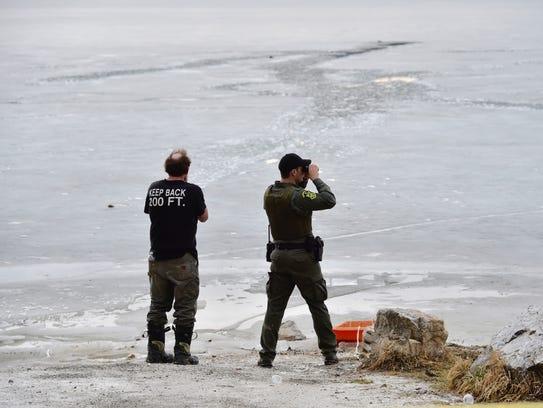 Rescue personnel congregate at Shelburne Pond where