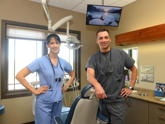 Carrie Ann and Chad Elkin opened their new office for
