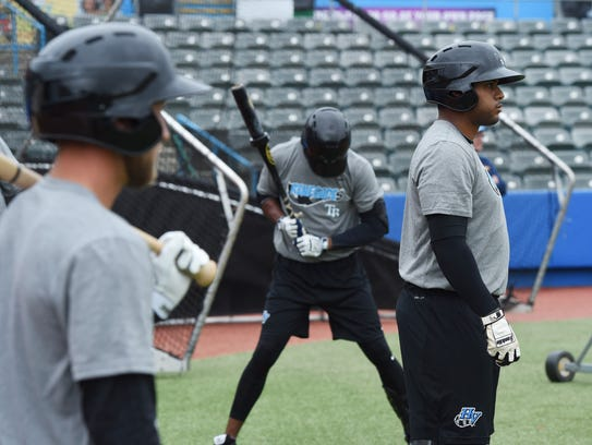 Renegades' Jean Ramirez, right, waits to step up to
