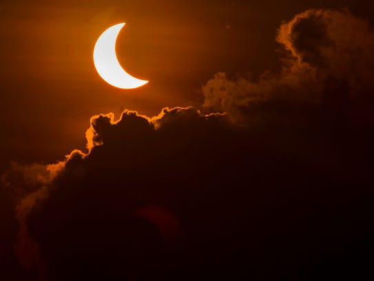 A solar eclipse is pictured from Banda Aceh, Indonesia,