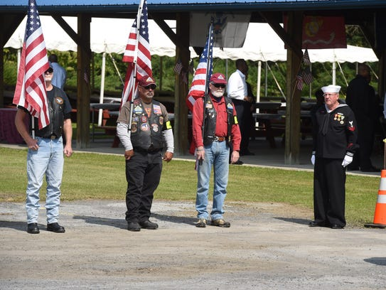 Patriot Guard Riders stand outside of the wake for