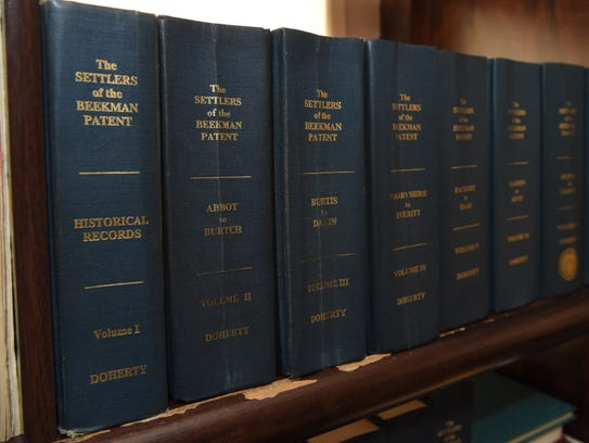 A view of several of the volumes Frank Doherty has written about the settlers of the Beekman Patent, seen in his home office in LaGrange.