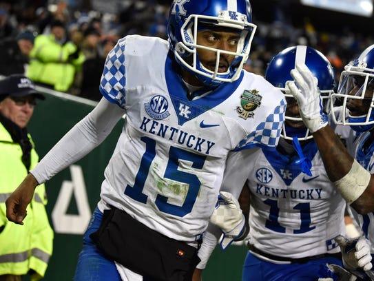 Kentucky quarterback Stephen Johnson (15) celebrates