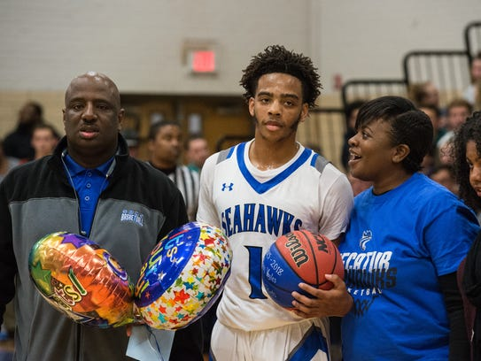 Stephen Decatur's Kevon Voyles (1) poses with his mother and coach after scoring after scoring 1,000 career points during game against Wi-Hi on Wednesday, Jan. 17, 2018.