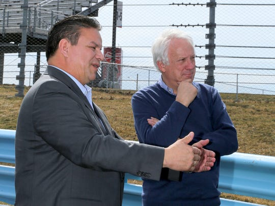 FIA's Charlie Whiting (right) listens to Watkins Glen International President Michael Printup on the front stretch after Whiting inspected Watkins Glen International track last year.