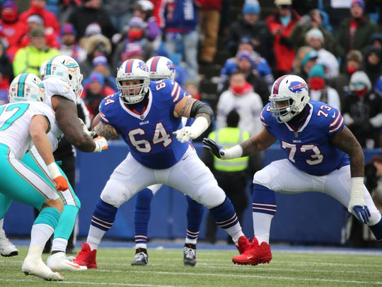 Unlike last year, Dion Dawkins (73) won't have retired guard Richie Incognito (64) next to him on the Bills' offensive line.