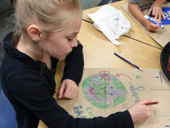 Deerfield Elementary student Isabelle Armstrong works
