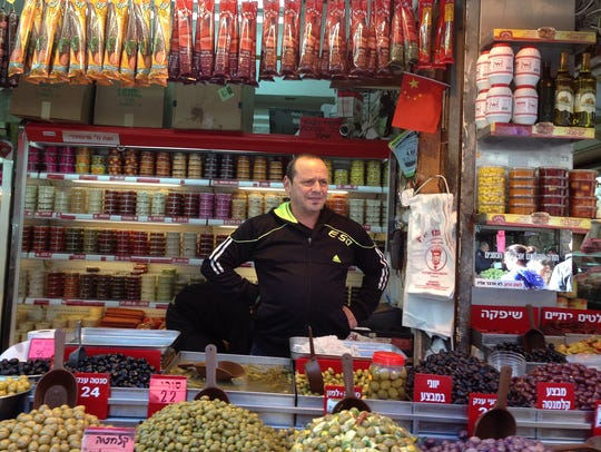 Shopkeeper Moshe Cohen watches over his space in the