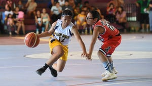 Yellow Jackets player Erin Moldez (17) crosses up an Island Chiefs defender during their 2017 Thanksgiving HoopFest Tournament Turkey Dash Division - 12U Coed championship game at the Tamuning Gym on Nov. 26, 2017. The Yellow Jackets won the game 42-21.