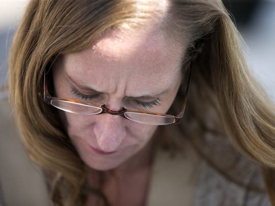 Michelle Calderon, of Tucson, looks on in the parking lot at the Pima County Juvenile Court Center in Tucson on March 1, 2017. Calderon just learned that her petition to get visitation with her daughter was denied. Calderon's daughter was taken away because of her drug abuse. The daughter was severely burned by her adopted mother from scalding hot water. The daughter was also previously placed with a different foster father who is now imprisoned for sex-crimes against children.