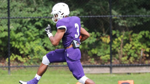 New Rochelle's Myles Taylor runs into the endzone for