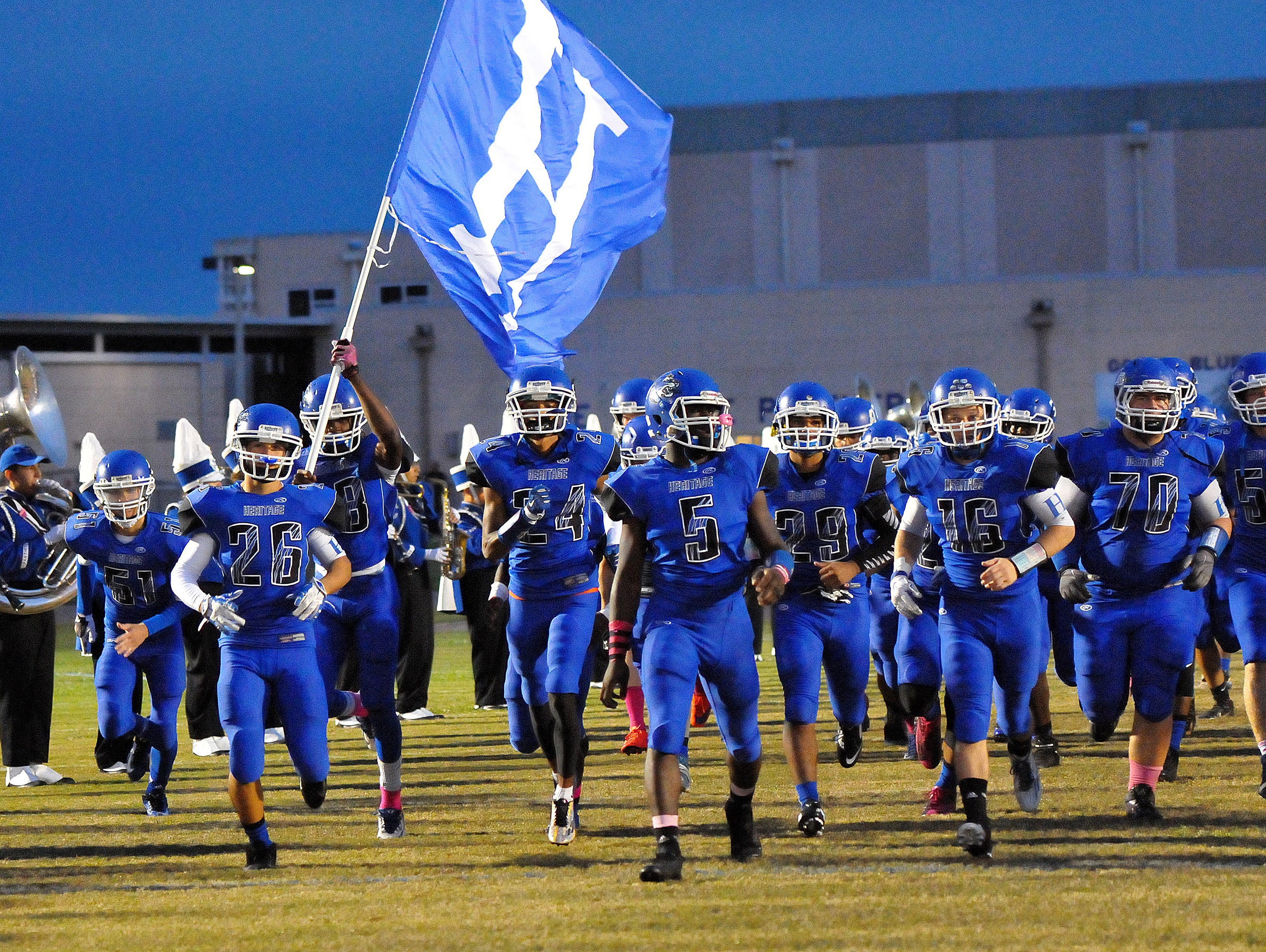 Heritage High players take the field for friday nights game against Sebastian River High held at Panthers stadium .