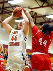 Dickson County's Kailey Rosenbaum (44) shoots as she's