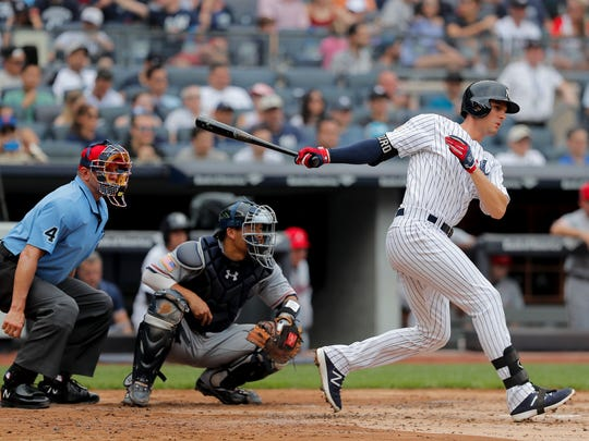 New York Yankees' Greg Bird connects for a base hit to drive in a run against the Atlanta Braves during the second inning of a baseball game, Wednesday, July 4, 2018, in New York.