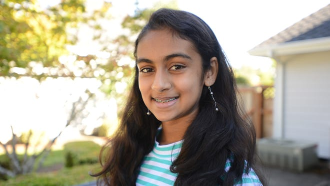 Megha Joshi of Blanchet Catholic School is among 300 semifinalists in a national science and engineering fair for middle school students called Broadcom MASTERS. Joshi created a solar-powered water filtration system. Photographed on Monday, Sept. 8, 2014.