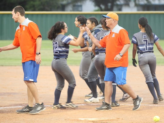 San Angelo Central High School head softball coach David Millsap (in cap) and assistant Josh Brewer shake hands with Killeen Shoemaker players after the Lady Cats rolled to a 19-0 shutout in the District 8-6A finale at the Central Softball Complex on Friday, April 20, 2018.