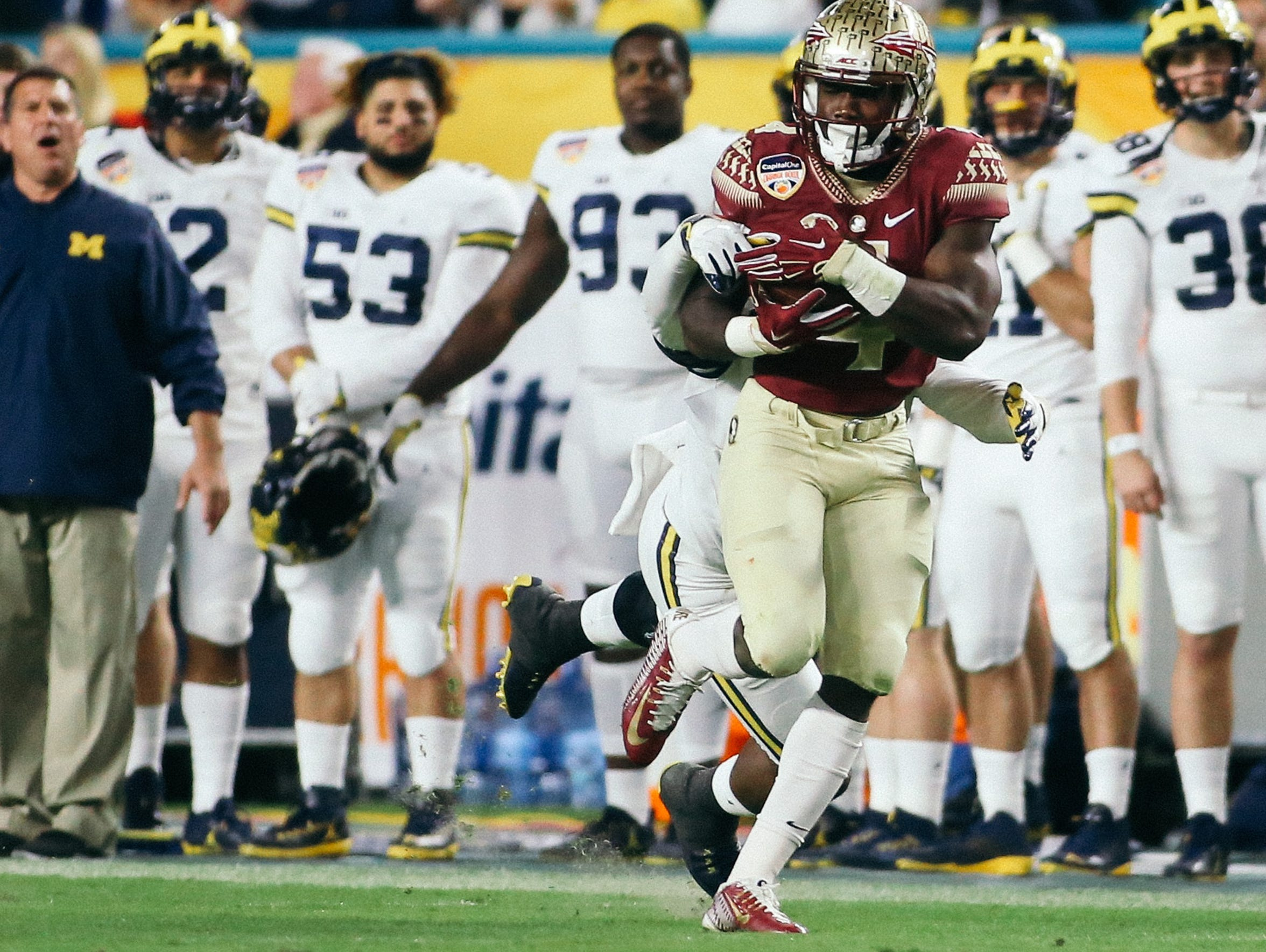 Dalvin Cook (4) catches a pass during the first half