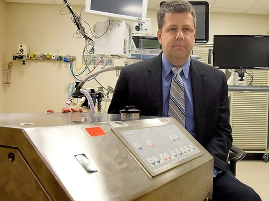 Dr. Hal Baker sits by a heater-cooler device that has been linked to infections at York Hospital. (Photo by Bill Kalina/ The York Dispatch)