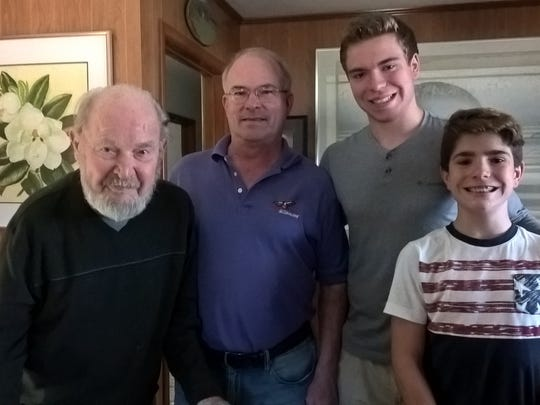 Dr. Henry A. Buchanan, of Gorman, celebrates his 96th birthday with his son Al and grandsons Alex and Anthony, of Chicago, Illinois.