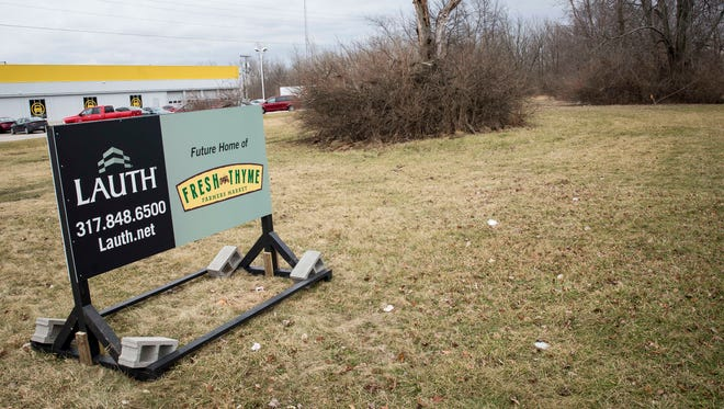 A sign marks the future site of a Fresh Thyme Farmers Market, a natural/organic grocery chain, on Jan. 31 along McGalliard Road. The business won approval from the Metropolitan Board of Zoning Appeals and the city-county plan commission to build a 29,00-square-feet store at the site.
