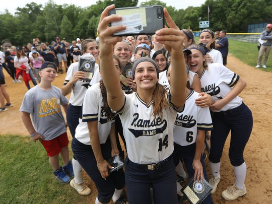 Victoria Sebastian, of Ramsey, holds her cell phone above her head to take a selfie with her teammates after they won the 2018 Bergen County title.