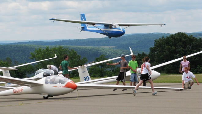 Gliders take part in a soaring competition at the Harris Hill field.