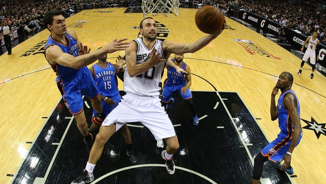 The Spurs' Manu Ginobili goes up for a shot Monday against the Thunder's Steven Adams in Game One of the Western Conference finals.