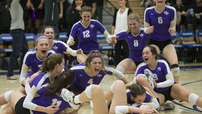 Scottsdale Notre Dame Prep players celebrate after winning the Div. II State Volleyball Championships against Goodyear Millennium in Gilbert November 10, 2015.