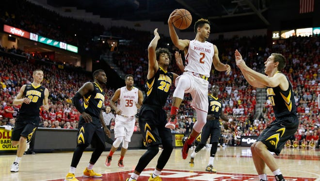 Maryland star Melo Trimble (2) was held to 11 points by Iowa, but the Hawkeyes had their own shooting struggles from outside, going 5-for-24 on 3-pointers.
