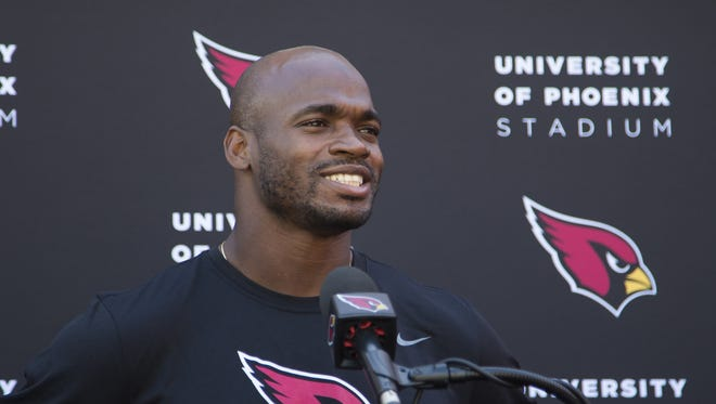 Arizona Cardinals running back Adrian Peterson talks to the media after practice at the team's training facility in Tempe, Ariz. October 11, 2017.