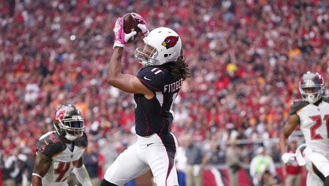 Arizona Cardinals wide receiver Larry Fitzgerald (11) catches a touchdown pass against the Tampa Bay Buccaneers during the second quarter at University of Phoenix Stadium in Glendale, Ariz. October 15, 2017.