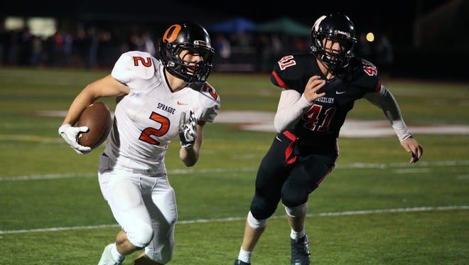 Sprague's Carter James runs the ball as the Olys defeat the McMinnville Grizzlies 49-27 in Greater Valley Conference game on Friday, Sept. 23, 2016, in McMinnville.