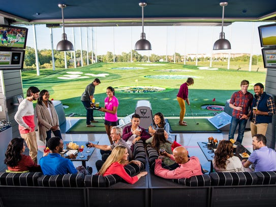 Guests playing golf at a Topgolf in Naperville, Ill.