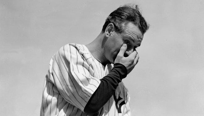 The New York Yankees' Lou Gehrig wipes away a tear while speaking during a tribute at Yankee Stadium in New York on July 4, 1939.