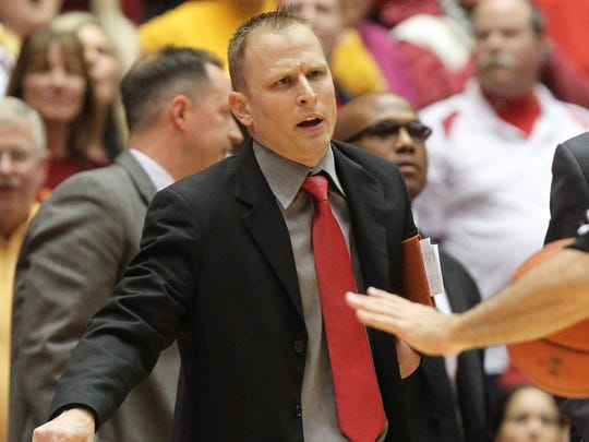 Iowa State Cyclones assistant coach Nate Loenser talks to officials during a January 2015 game against Kansas State.