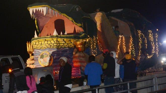 Floats cross the Jackson Street Bridge into Alexandria last year during Pineville's first Light the Night Mardi Gras parade.